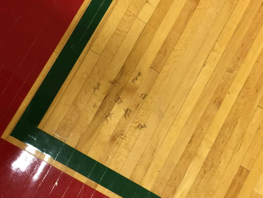 signatures on floor (part of story)
