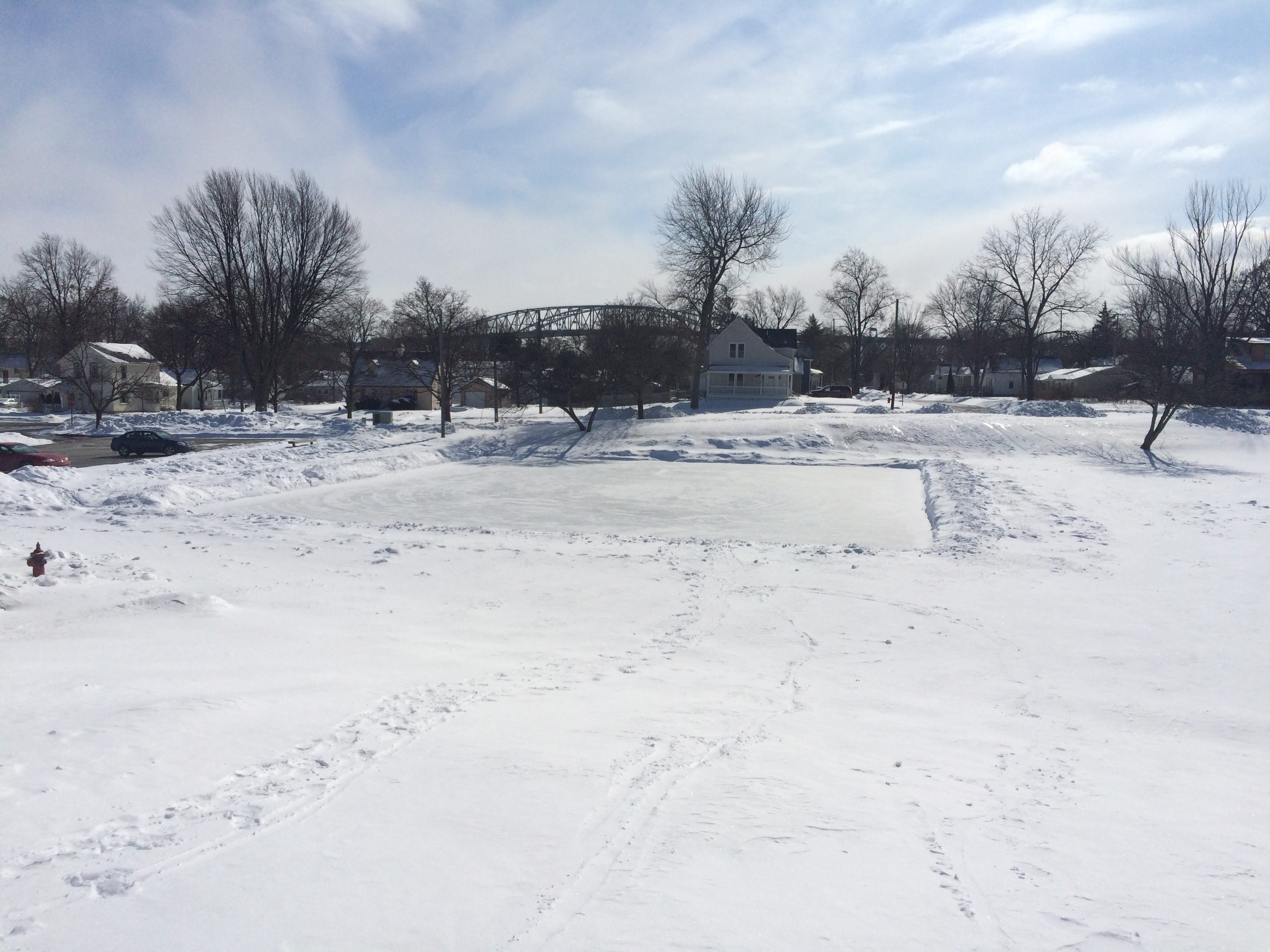 The Blue Water Bridge can be seen in the background behind the ice rink at Palmer Park. The rink will play host to a 3-on-3 pond hockey tournament Sunday.