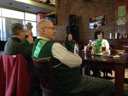 CelticFest grand marshal Mino Duffy Kramer listens to a conversation with Fort Gratiot resident Kathleen McEwen and others at her table Friday morning at Lynch's Irish Pub in Port Huron.