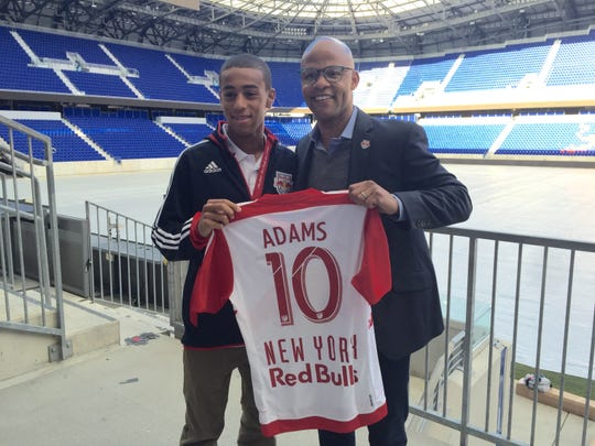 Tyler Adams, left, poses in March 2015 at Red Bull Arena in Harrison, New Jersey, with Ali Curtis, the sporting director for the New York Red Bulls.