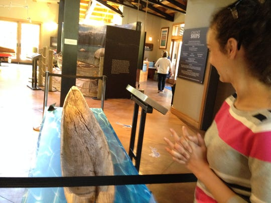 Christine Shook of the Tahoe Maritime Museum in Homewood looks over a Washoe canoe that is part of the museum's Ghost Ships exhibit.
