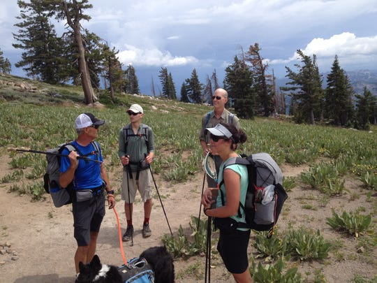 Jeff Baird, owner of Cedar House Sport Hotel, hiker and adventurer Justin Lichter, Gossamer Gear founder Glen Van Peski and hiker and adventurer Liz Thomas take a break during an overnight backpacking trip in the Tahoe National Forest.