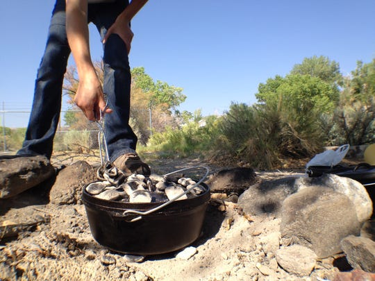 Coals beneath and on top of a Dutch oven conduct heat that cooks the food. There's a Dutch oven competition Saturday, Aug. 16 at Lahontan State Recreation Area in Silver Spring.
