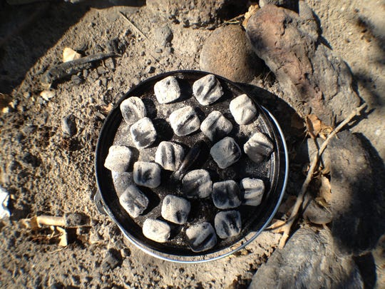 Because heat rises Dutch oven cooks use more coals on top of the oven than the bottom. The cast iron oven conducts heat to cook food inside. Expert cooks know just how many coals to use to achieve the desired level of heat.