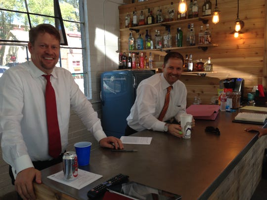 Josh Griffin and Matt Griffin behind the bar at the Tesla lobbyists headquarters.