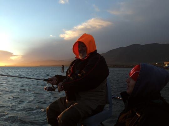 Angler Phil Dominick, left, of Chicago, and guide Rob Anderson of Reno fish the North Nets area of Pyramid Lake on Nov. 29, 2014. Dominick, 67, is a lifelong sportsman who since going blind 13 years ago often relies on guides. Anderson is broadening his guiding business to include more disabled clients.