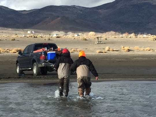 Guide Rob Anderson of Reno helps Phil Dominick of Chicago back to shore during a fishing trip to Pyramid Lake. Dominick is blind and Anderson is seeking to expand his business to include more disabled clients.