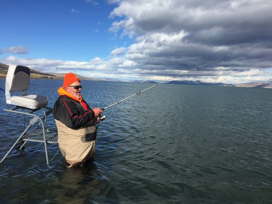 Angler Phil Dominick of Chicago fishing next to a ladder at Pyramid Lake on Nov. 29, 2014.