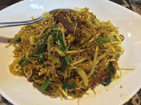 An old standby: Singapore noodles (here ordered with extra curry).