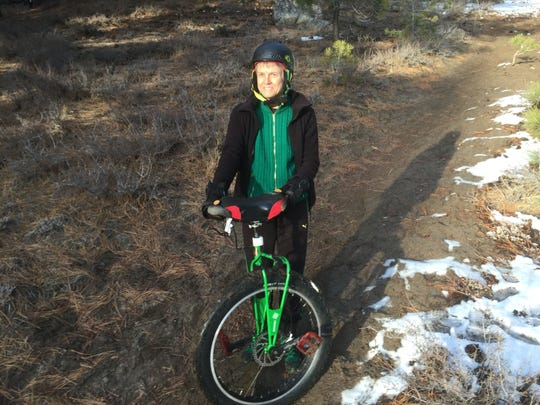 Wynn Walker of Minden poses with one of several unicycles she owns. Walker is one of the few people who enjoys the sport of mountain unicycling.