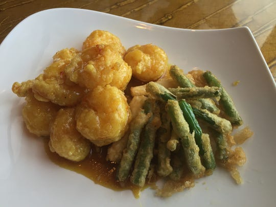 Curried shrimp are new on Jazmine's dinner menu. They're tossed in coconut milk and curry, with tempura green beans on the side.