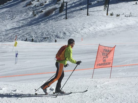 Ski mountaineer and alpine guide Dave Riggs skis uphill at Sugar Bowl Resort in Truckee, Calif., on Friday, March 6.
