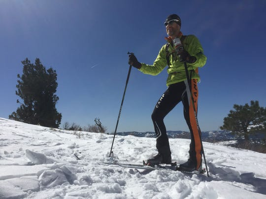 Top of the mountain: Dave Riggs, 53, of Truckee, Calif., enjoys a few moments in the sun after skinning uphill March 6 at Sugar Bowl Resort. Now comes the rewarding part, skiing down.