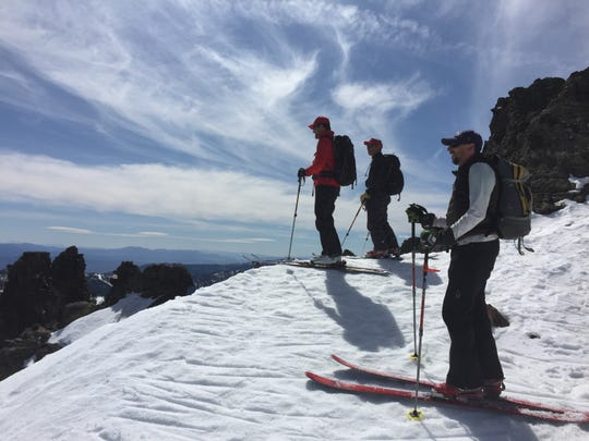 Daniel Ellsworth of Reno, Tim Gavin of Incline Village and Michael Mosca of Meyers, Calif., prepare to ski from Rose Knob Jr., peak in the Tahoe Basin on March 28, 2015.