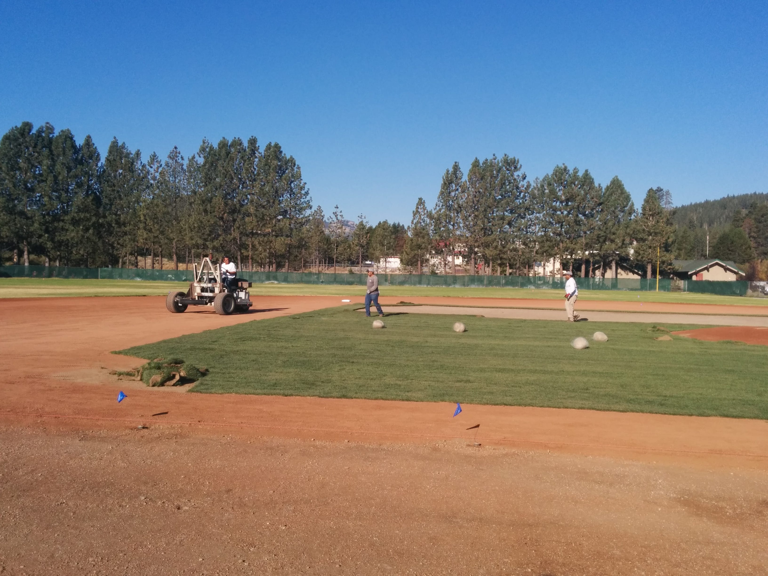 Workers prepare the infield at the Truckee basbeall field.