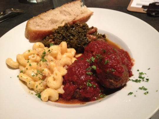 Orbs plate: beef balls with marinara, mac and cheese, and sautéed greens and white beans.
