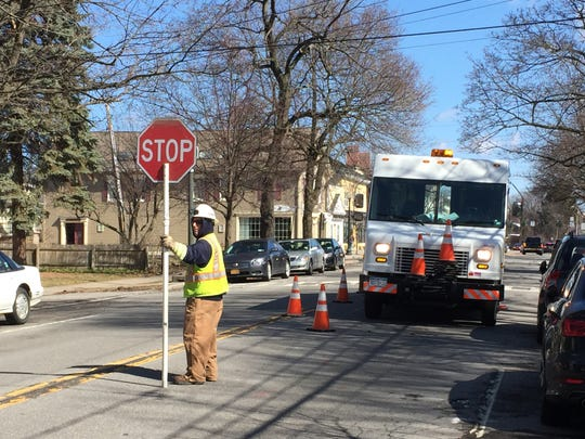 An RG&E crew works to restore a power outage in Pittsford on April 4.