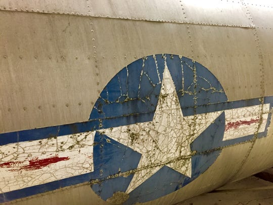 A B-17 Flying Fortress, which has this emblem on the fuselage, will be restored in a hangar at Salem Municipal Airport.