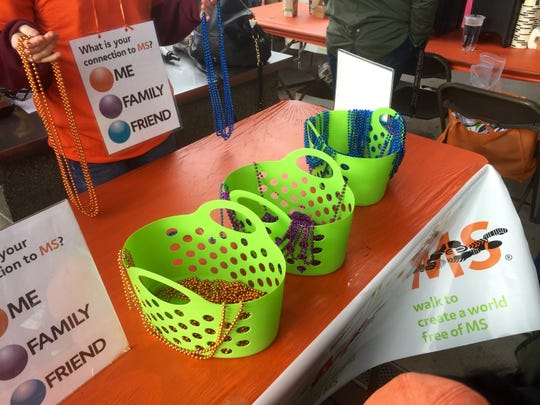 Each person at Salem's multiple sclerosis walk Saturday, April 11, wore beads. Those living with multiple sclerosis wore orange beads, those who were supporting a family member wore blue beads, and those supporting a friend wore purple beads.