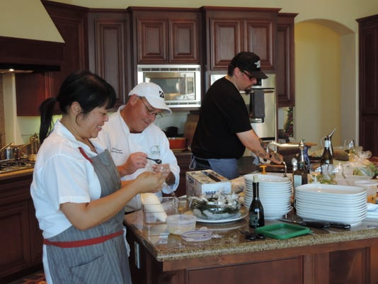 Michelle Lee, Kirk Larsen and Cy Yontz prepping for dinner.JPG
