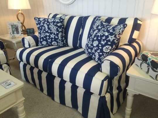 Keep the nautical theme with bold stripes on a couch slipcover.