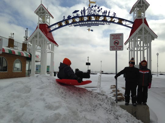 The Cyburt brothers, Elvis, Cash and Sloan, plus sister Ace, all of Ocean Pines, enjoy their snow day in downtown Ocean City on Friday.