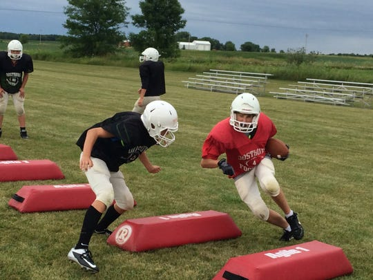 Oostburg players run through a tackling drill during a recent training camp practice at the high school.
