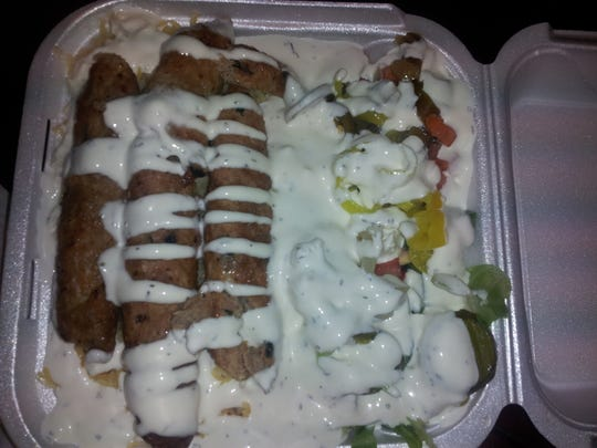 The Kofta Kabob was said to be like spicy chicken sausage, and it came covered in sauce.