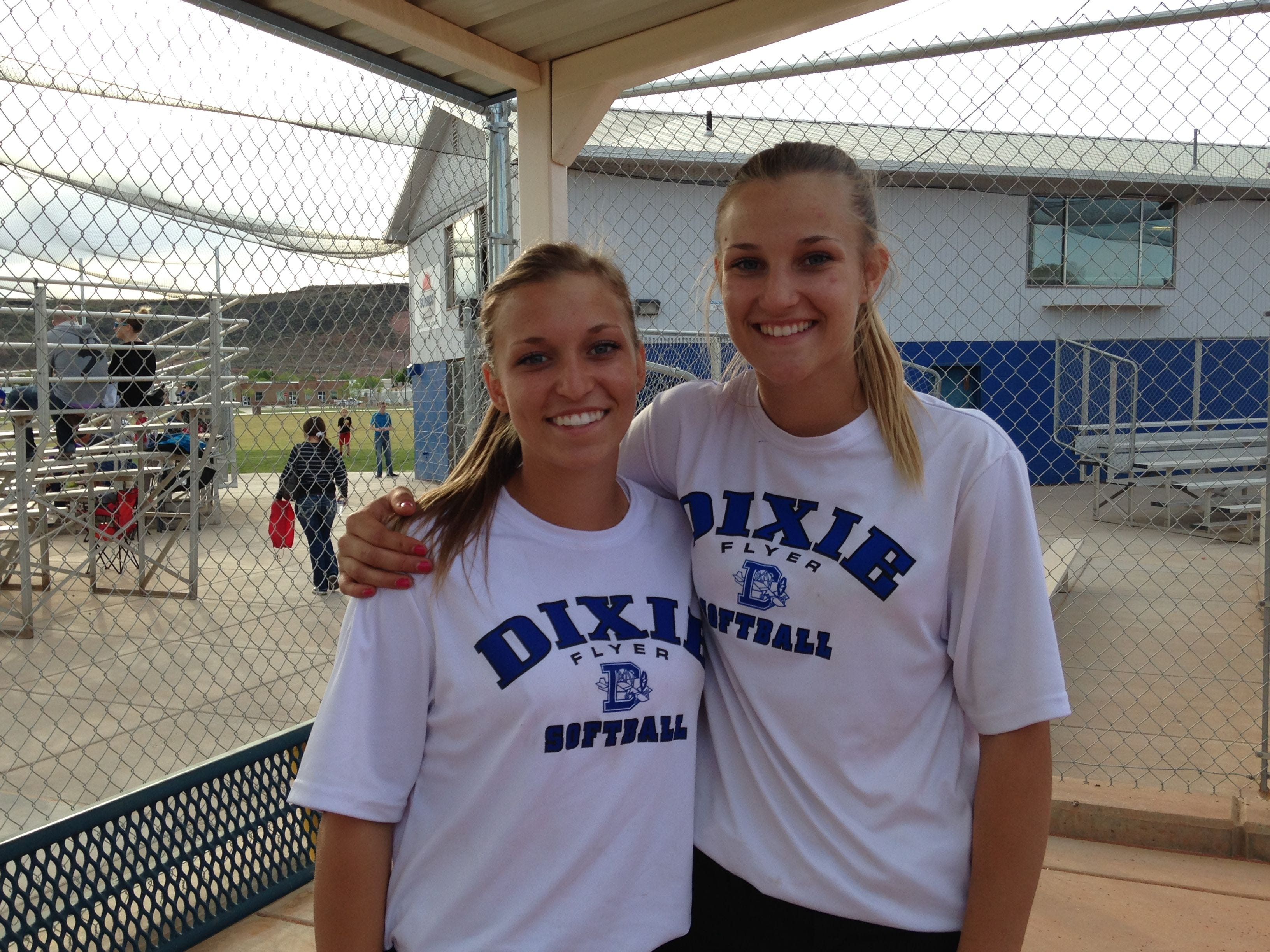 Shaunna (left) and Stacia Gelter are twin sisters who play for Dixie High Softball. Their older sister, Sheila, plays for Dixie State University.