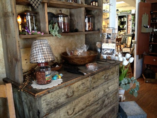 A buffet is offered for sale at Whetstone's Antiques.