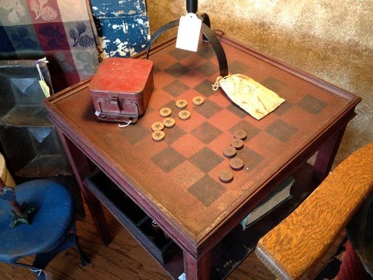A checkers/chess table reminds shoppers of days before online gaming.
