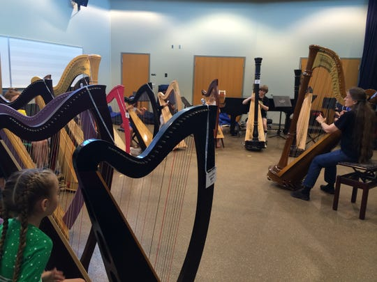 Mary Kay Waddington, a Suzuki harp instructor from Denver, leads a class during the American Suzuki Institute at the University of Wisconsin-Stevens Point Wednesday.