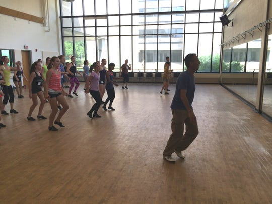 """Mark Goodman works with a class on Friday during the Point Tap Festival at the University of Wisconsin-Stevens Point. One of Goodman's students, Zack Everhart, is currently a finalist on the television show """"So You Think You Can Dance."""""""