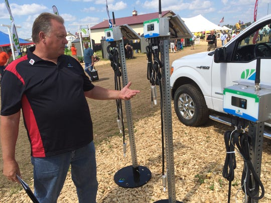 Dave Zywicki, regional sales manager of Horatu, shows some of the company's irrigation systems during Farm Technology Days.