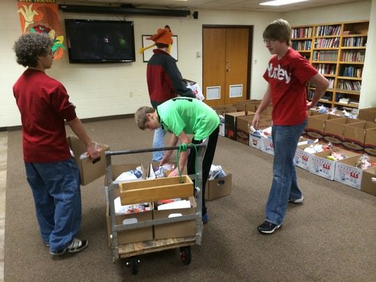 Volunteers load up boxes to bring to people's vehicles on Saturday during the sixth annual Thanksgiving Basket event at St. Paul Lutheran Church in Stevens Point.