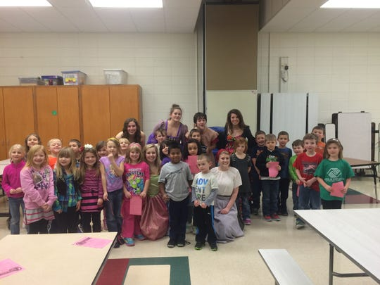 "The cast from Stevens Point Area Senior High's production of ""Cinderella"" poses for a photo with kindergarteners from Kennedy Elementary School in Junction City. The cast visited the school to promote their upcoming musical."