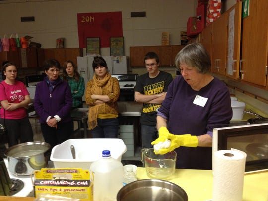 Rose Boero of Tea Rose Farmstead in Custer demonstrates how to make mozzarella cheese during one of a number of workshops held as part of the 2014 Local Food Fair.