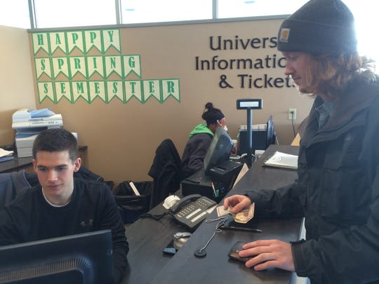 University of Wisconsin-Stevens Point student Elliott Schuette purchases a ticket Monday for the April 23 Juicy J concert from the UWSP ticket office in the Dreyfus University Center.