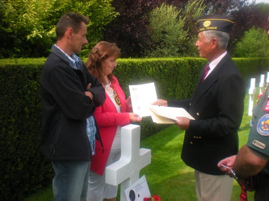 Krista Thys officially adopts the grave of George Steven March of Orosi in August at Flanders Field American Cemetery in Belgium. Her husband of 21 years, Erik Quirijnen, is at left.