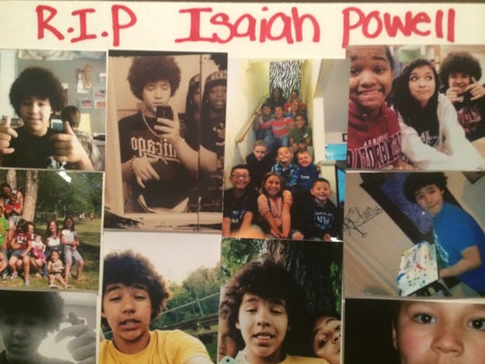 One of several poster boards with photos of Isaiah Powell on display at his funeral on Friday.