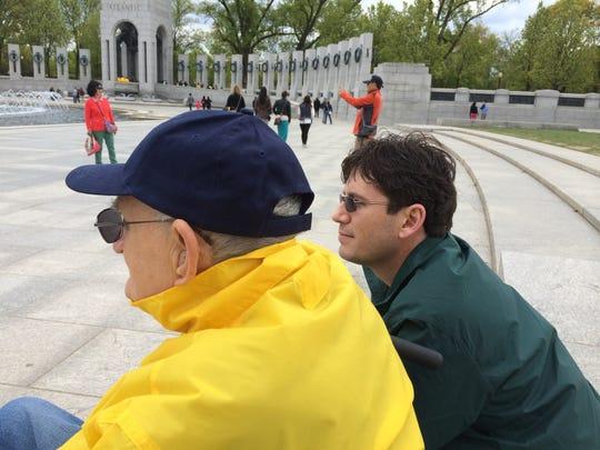 World War II veteran Joseph Nawrocki, 93, and his grandson Adam Nawrocki of Minneapolis take in the sights at the World War II Memorial at Washington, D.C.