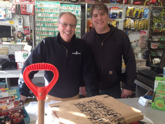 Joe Zeolla, left, owner of Ardsley Hardware, with customer Chris Goercke, who stopped by on Dec. 31, 2014 for a bag of calcium chloride and a snow shovel, despite there being no snow in the forecast.