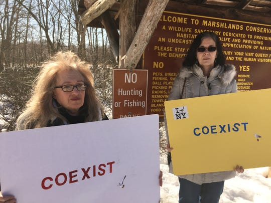 Kiley Blackman and Adrienne Hernandez, members of Animal Defenders of Westchester, at the Marshlands Conservancy on Feb. 27. The group opposes killing deer and favors a sterilization program.