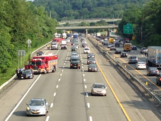Traffic crawls past an accident on eastbound Interstate 287 between the Interstate 684 and Hutchinson River Parkway exits on July 23, 2014, in a photo taken from the Corporate Park Drive looking toward White Plains. (Thane Grauel/The Journal News0