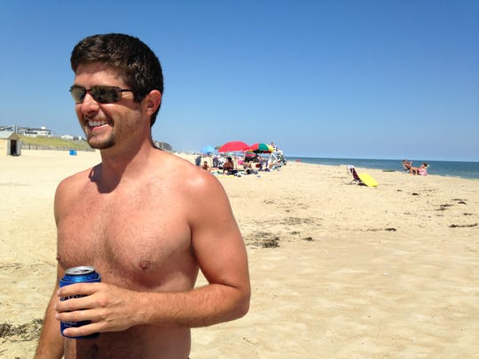 Travis Diehl takes a beer to South Bethany, where alcohol is permitted.