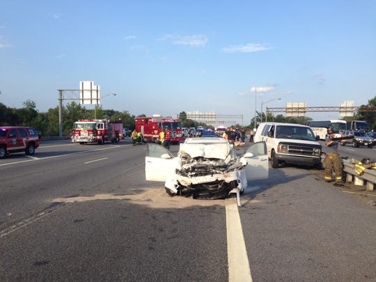 A two-vehicle crash in which one of the cars caught on fire has all lanes blocked on I-95 south at Del. 141.