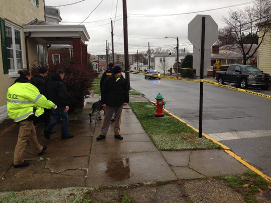 City police investigate a shooting of Malik Watson in New Castle in 2014, the city's first homicide since 1999.