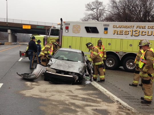 Claymont Fire Department works to extricate a woman who was trapped Sunday morning on I-495 northbound.