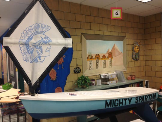 The Mighty Spartan sits inside Lake Forest Central Elementary School before being launched. The 4-foot-long boat survived more than three months on the open seas and landed in Ireland.