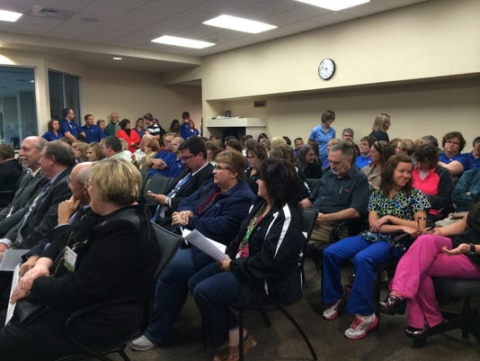 A crowd gathers at Wisconsin Rapids Council